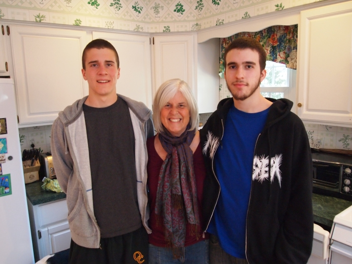 my giant son Adam, me and Alex in my kitchen