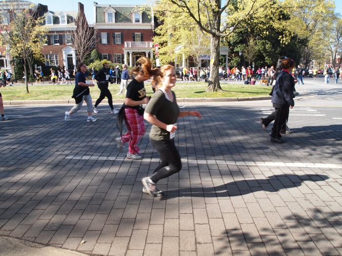 Sarah runs by at the Monument Avenue 10K