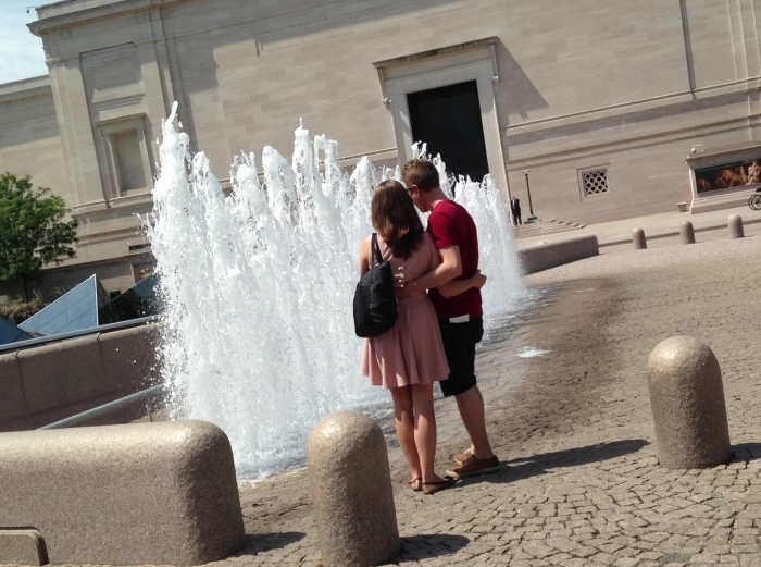 a couple interacting with the fountain!!