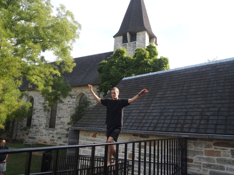 Adam balances on the church railings