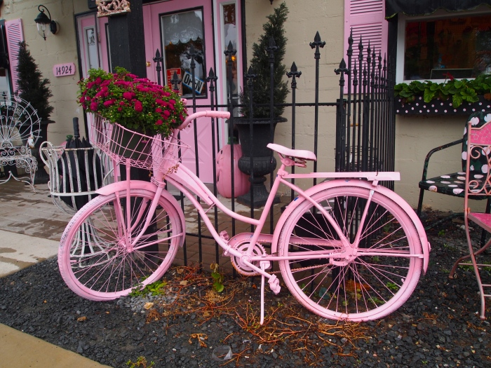 another pink bicycle flanking the entrance