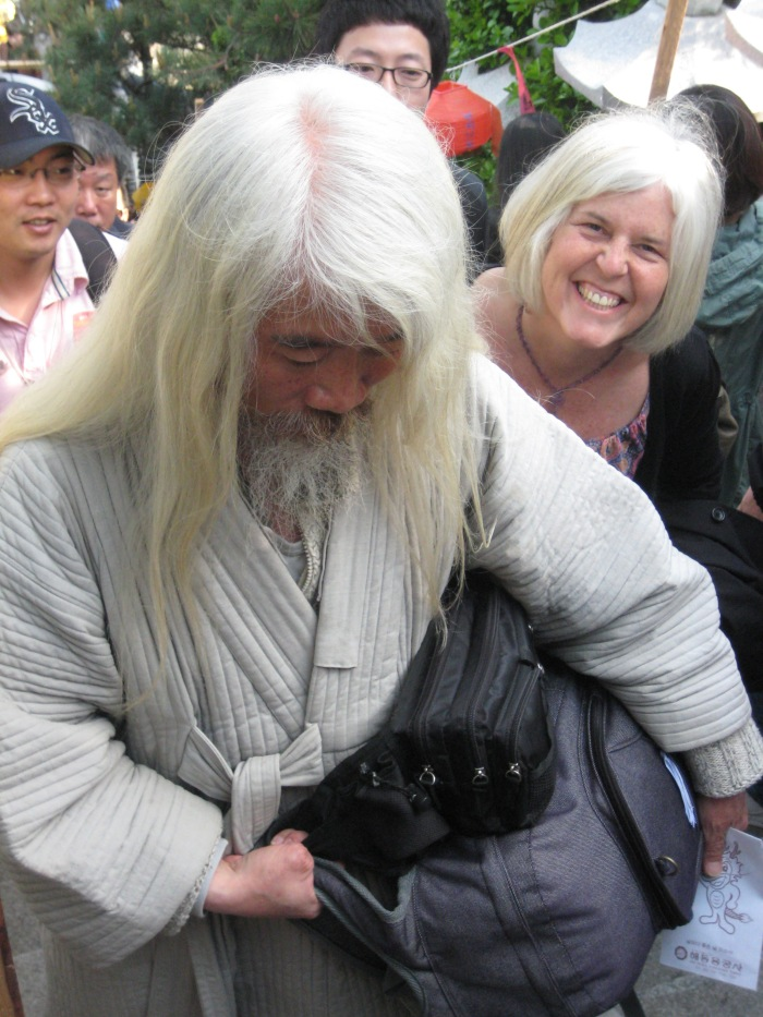 a white haired monk at  Donghae Yonggung-Sa in Busan, South Korea