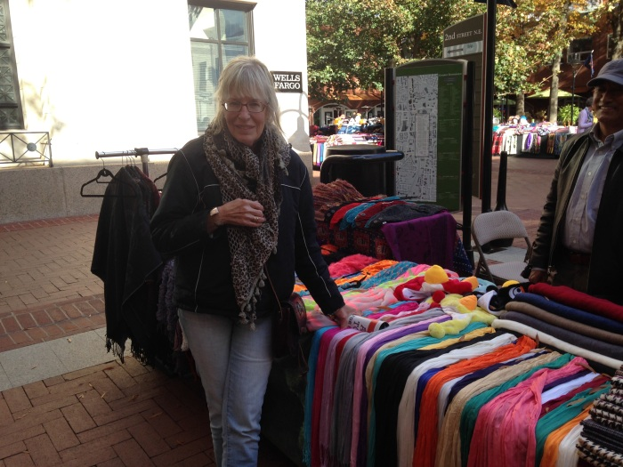Susan at an outdoor vendor's table