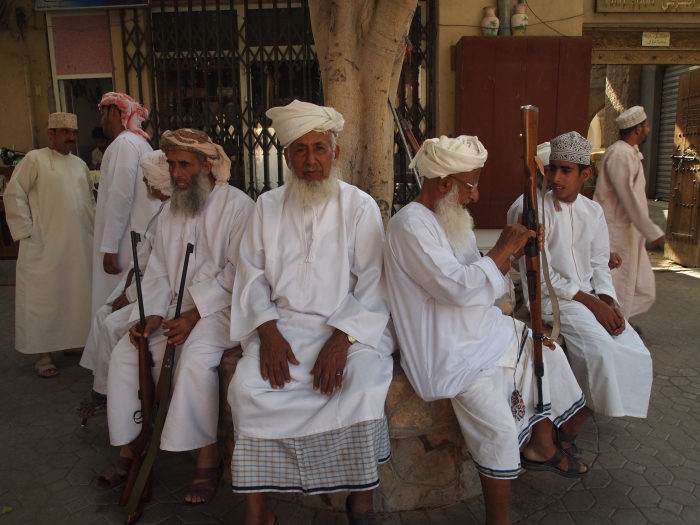 Omani men and their guns at Nizwa souq