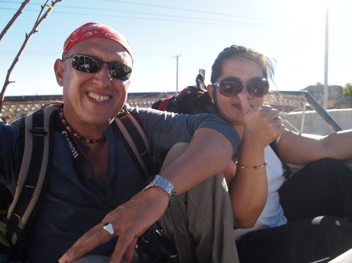 hitchhiking in the back of an Omani pickup truck - Mario and Kathy