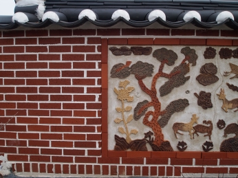 wall with Korean art and roof tiles