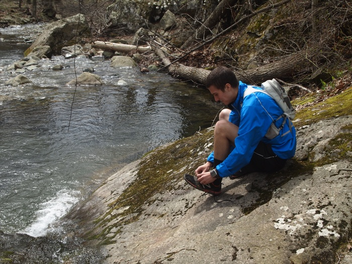 Adam prepares for hiking