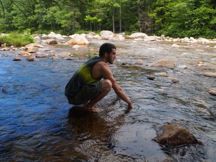 Alex gets his feet wet in the river
