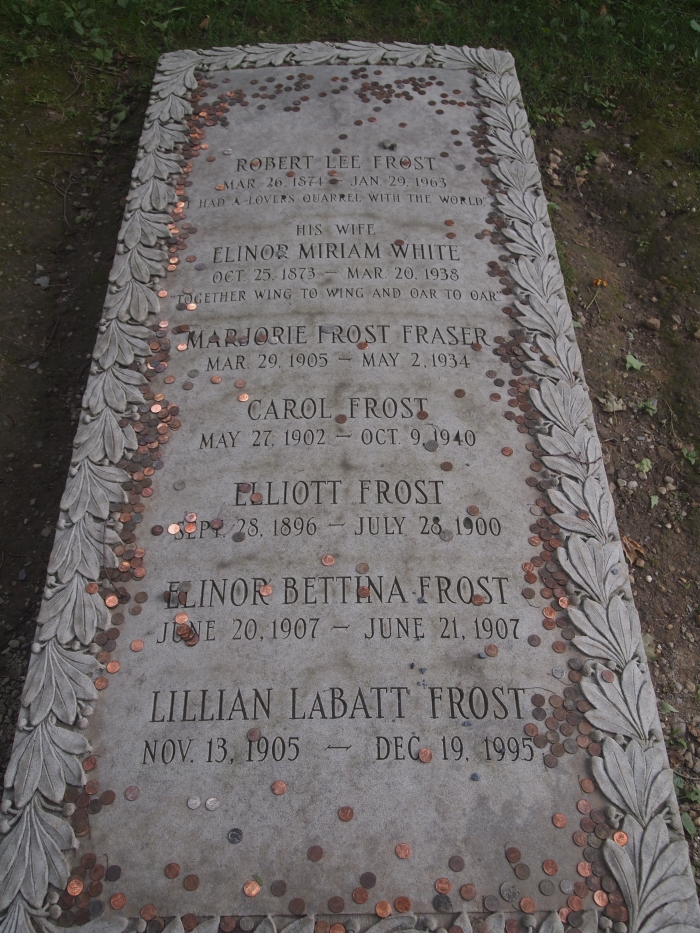 Robert Frost's grave, scattered with pennies