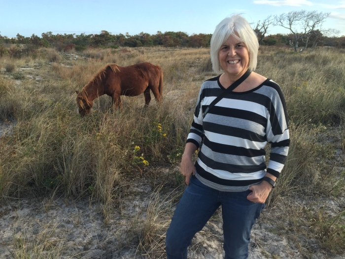 me with one of the wild ponies of Assateague