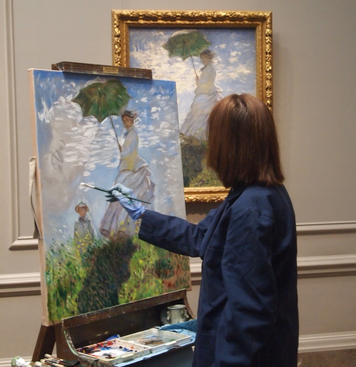 an artist painting a famous painting, Woman with a Parasol, by Claude Monet