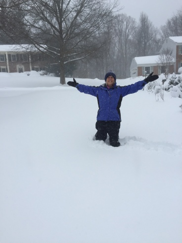 me knee-deep in the snow in our driveway