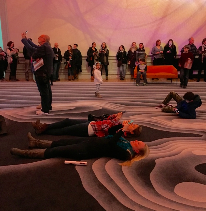 people on the carpet observing Janet Echelman's 1.8