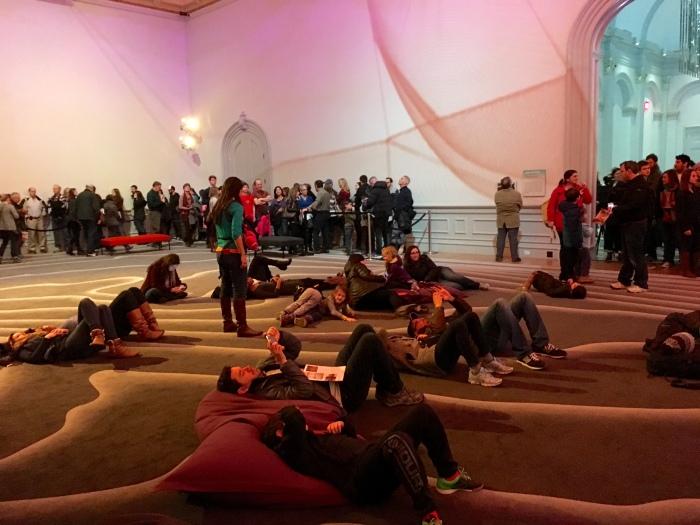people on the carpet observing Janet Echelman's 1.8