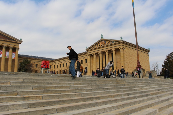 Mike runs up the Rocky steps