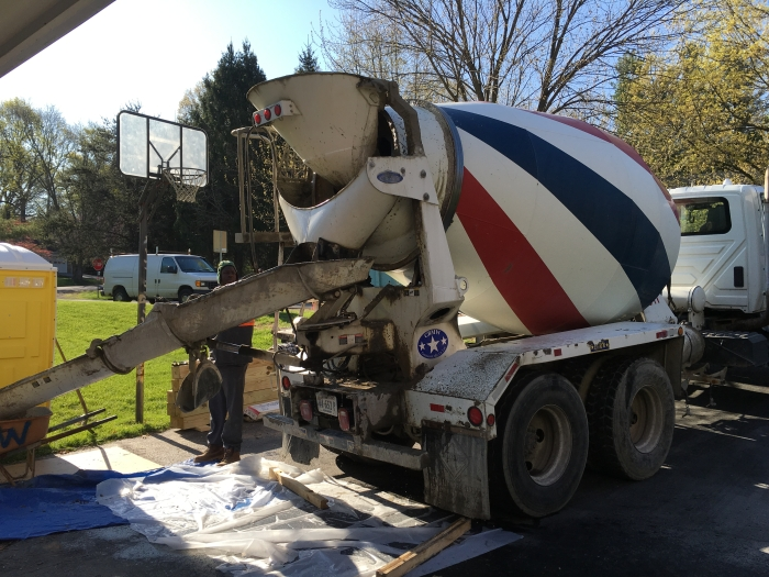 Concrete arrives for porch footings