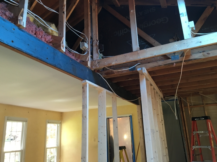 the steel beam is sandwiched between two beams to replace the load-bearing wall