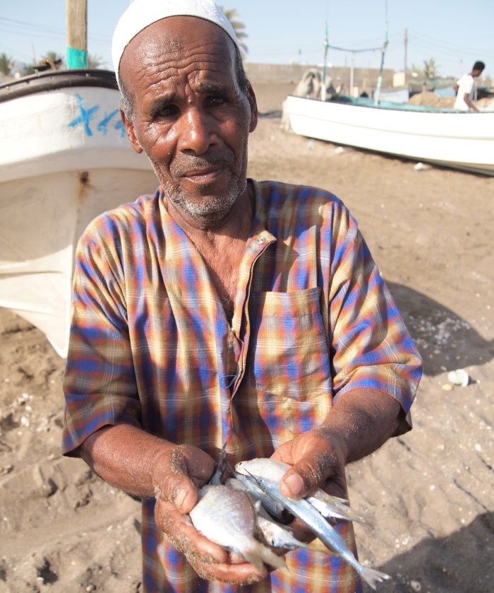 a fisherman at the beach at Al Musanaah