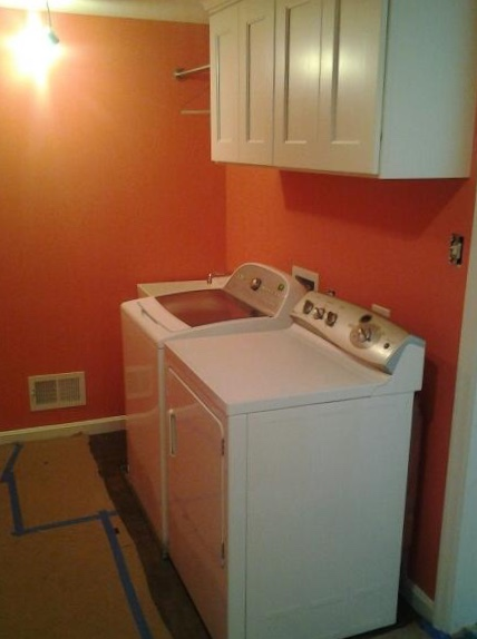 Our laundry room: Sherwin-Williams Coral Reef