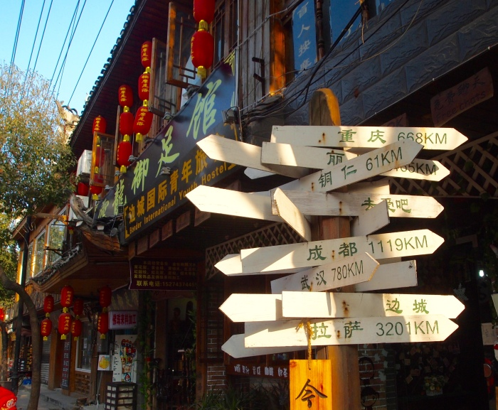 Numbers telling distances to exotic locales - Fenghuang, China