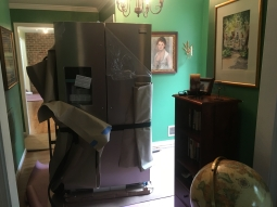 bringing the refrigerator in through the foyer