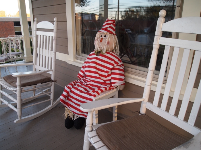 a strange character on the front porch of The Historic Morris Harvey House