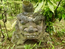 stone face at the Nezu Museum Garden